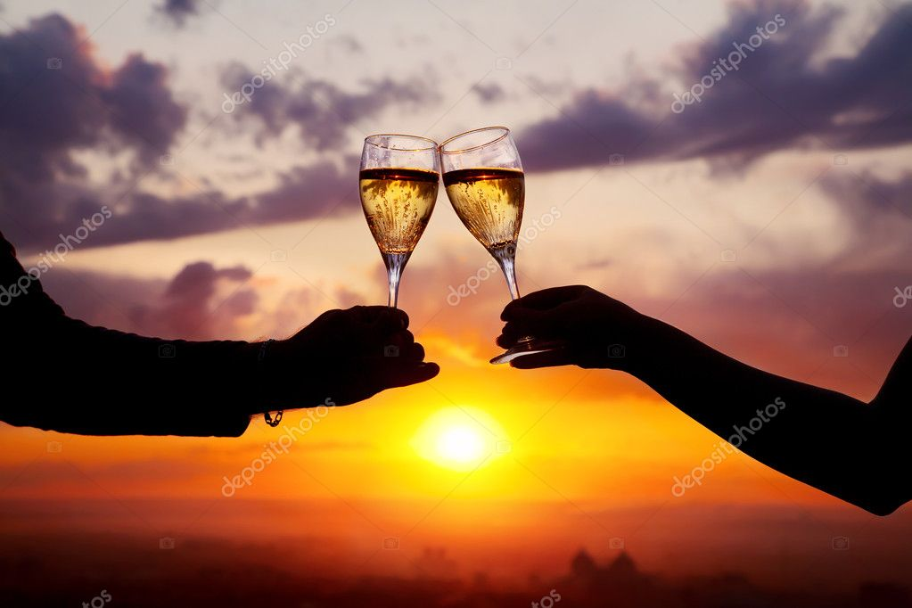Glasses with champers at sunset