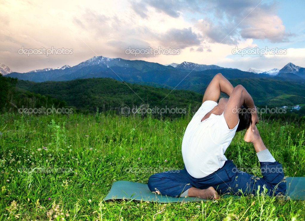 Yoga Eka Pada Rajakapotasana pose in mountains