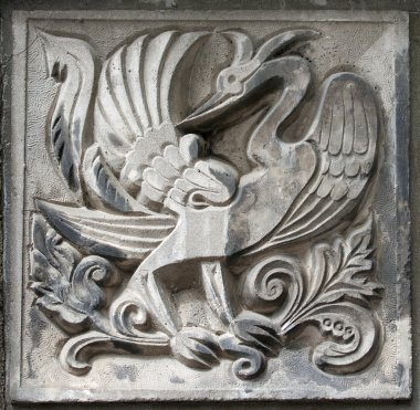 Old bas-relief of fairytale firebird