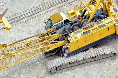 Yellow construction crane truck