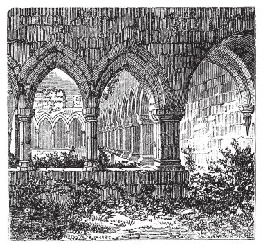 Gothic cloisters and arch at Kilconnel Abbey, in County Galway,