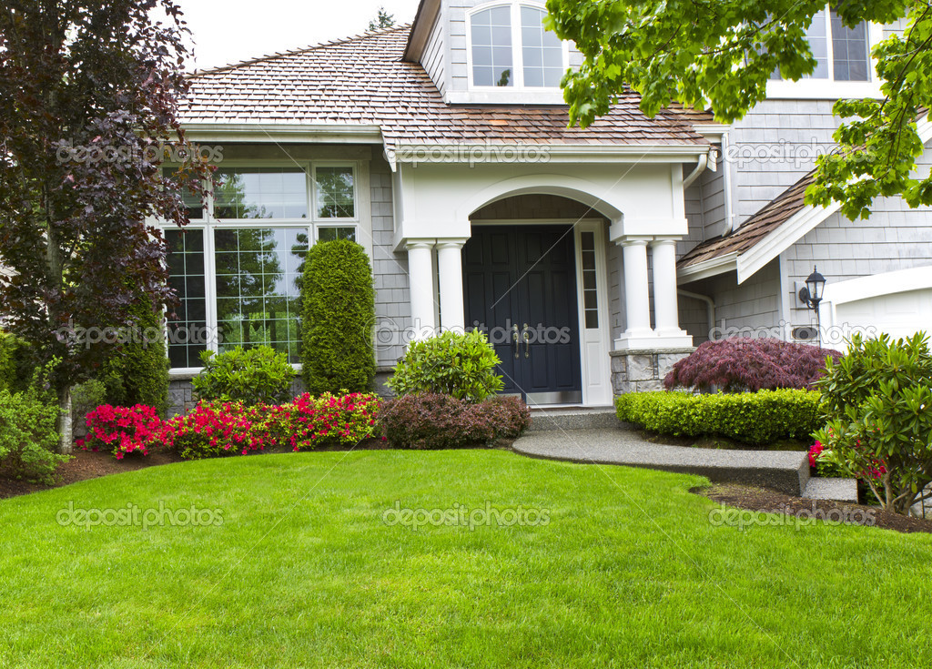 Green front yard and flowers with home stock photo for Good house photos
