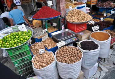 Spices and nuts on the scales and dishes in an old bazaar in Tehran, Iran