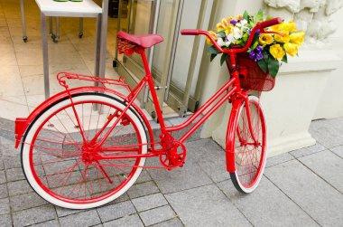 Vintage red bicycle in the street