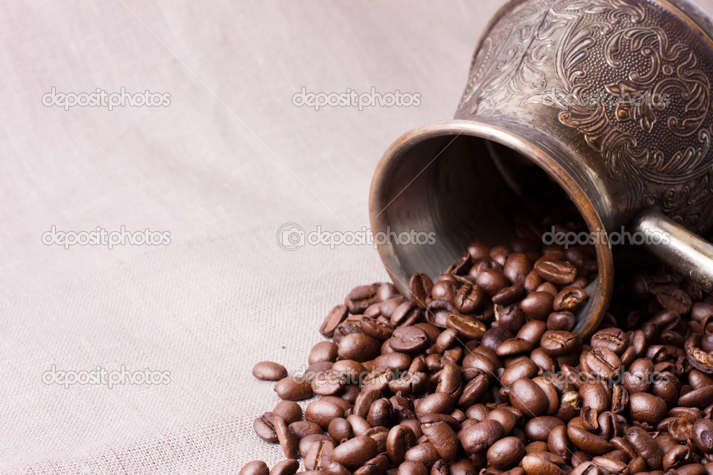 Coffee beans with coffee pot