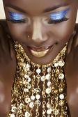 Fényképek afrikai nő, arany