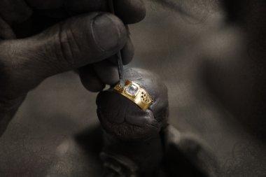 Goldsmith and diamond ring.