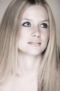 Blond teenage girl with blue eyes