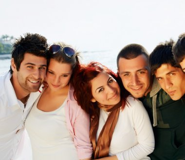 Young Turkish student group of friends in a row with faces close at the sea stock vector