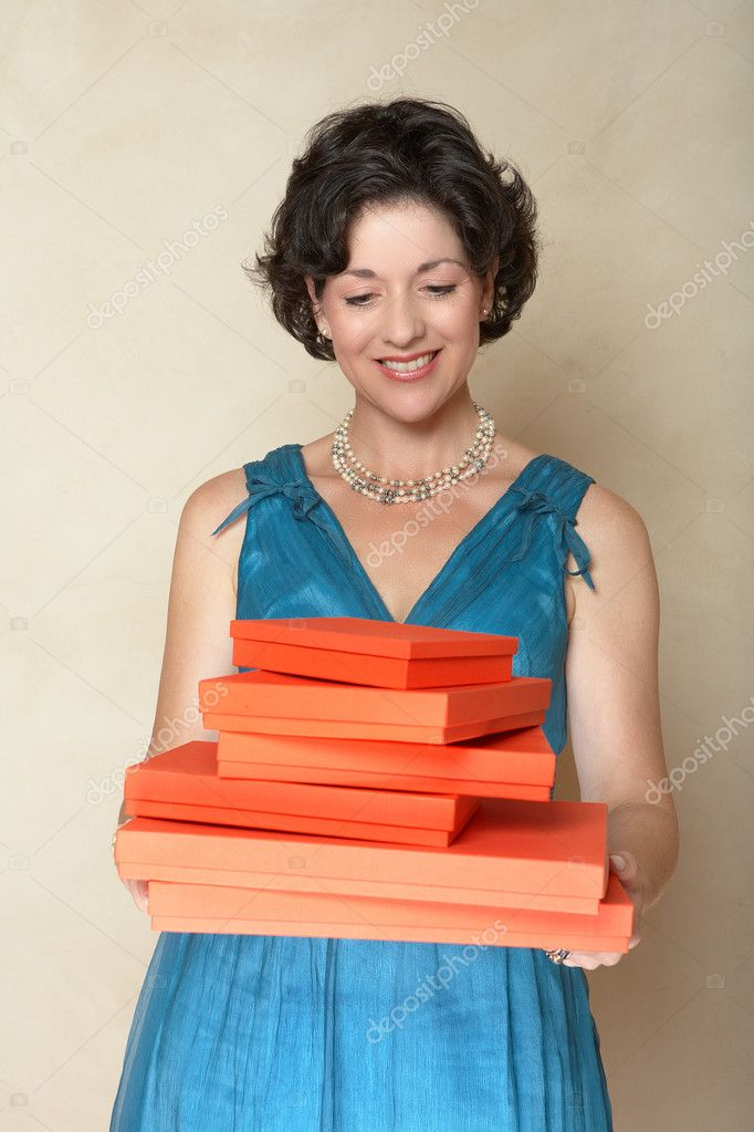 Woman with red gift boxes.