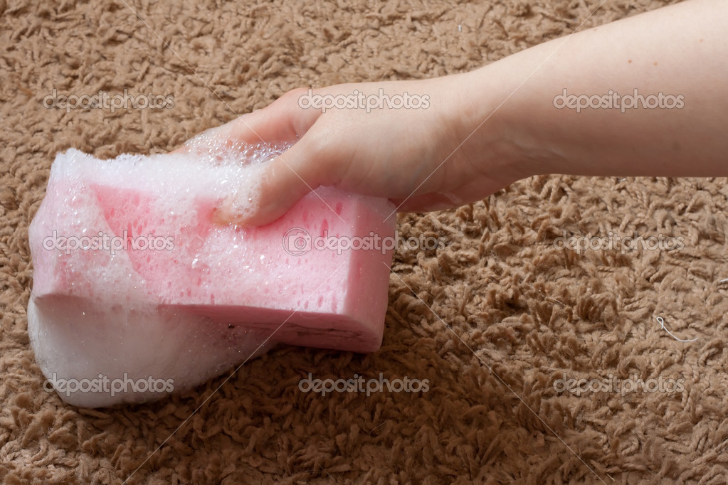 Pink wool carpet cleaned with foam