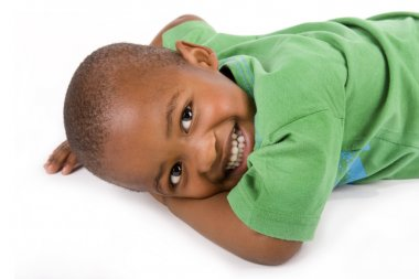 Adorable 3 year old black or African American boy with a smile