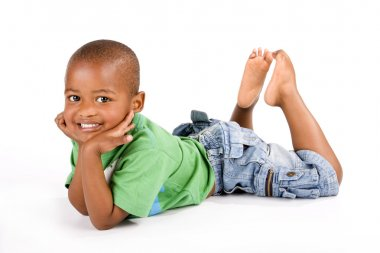 Adorable 3 year old black or African American boy with a big smile