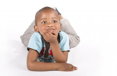 Adorable 3 year old black or african-american boy smiling hands on chin
