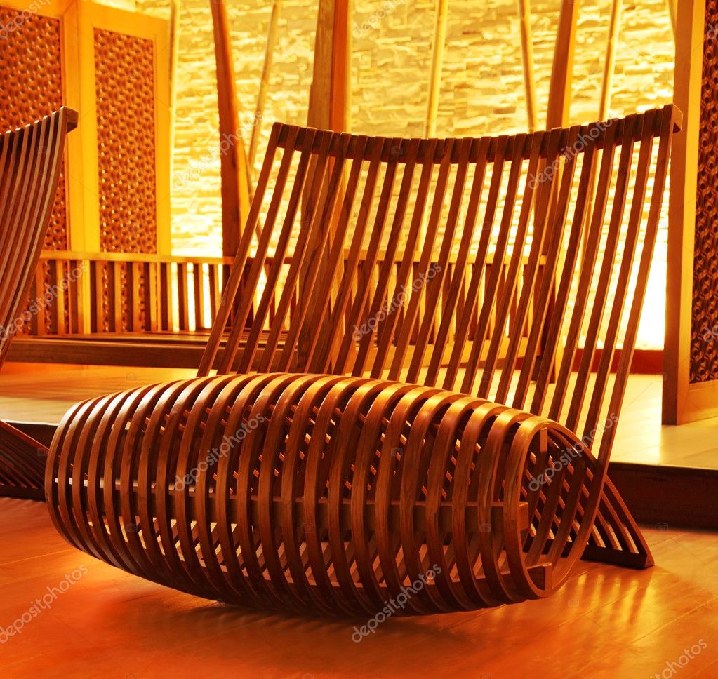 Wooden modern designed armchair with cozy warm lights