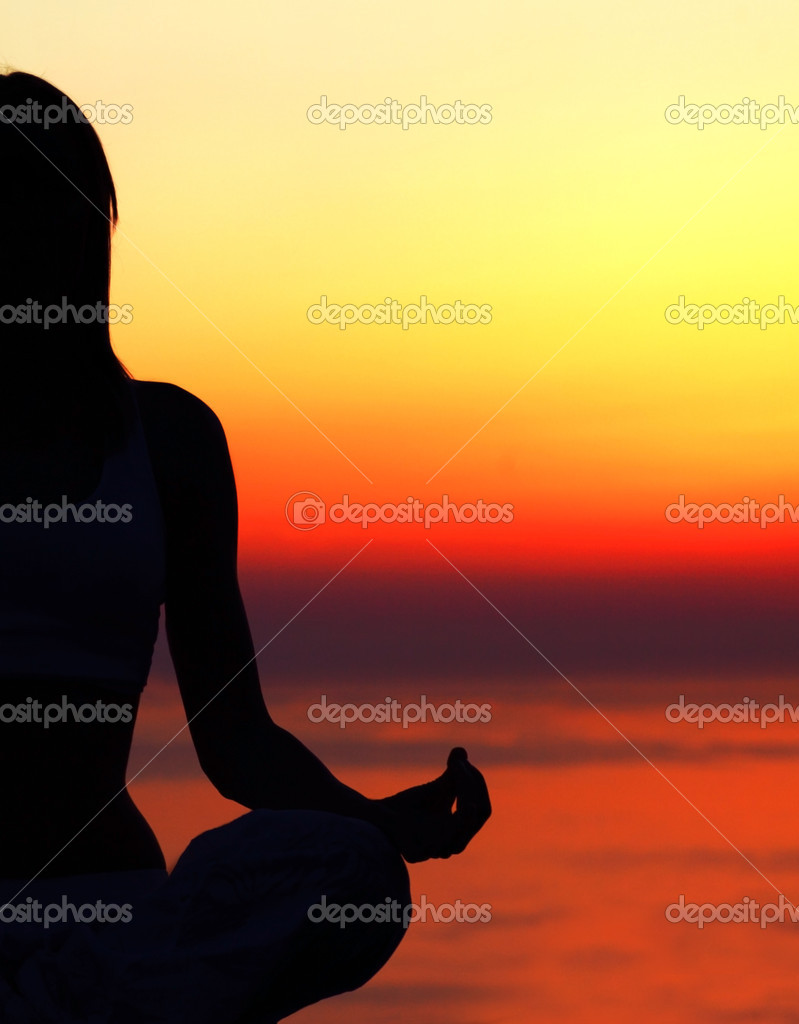 Yoga woman over sunset