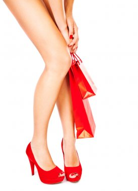 Beautiful female legs, red fashion, shopping concept