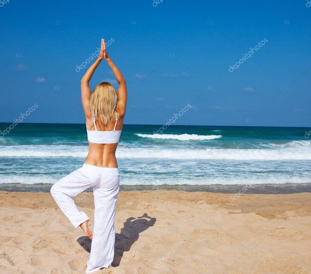 Healthy yoga exercise on the beach