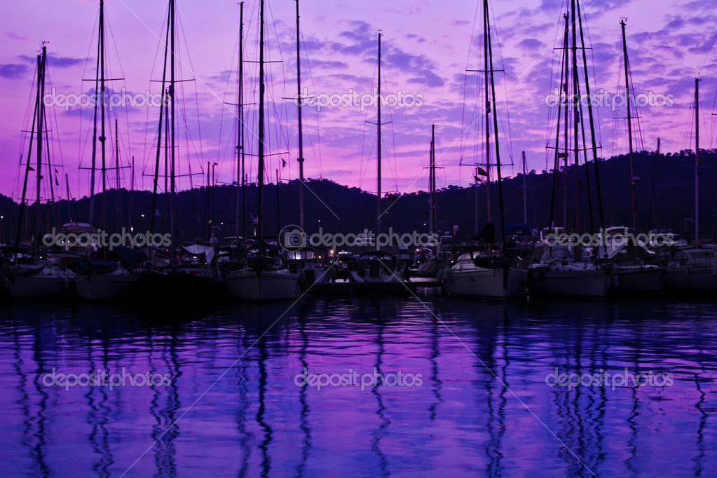 Yacht port over purple sunset