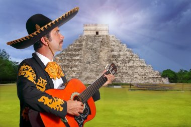 Charro Mariachi playing guitar in Chichen Itza