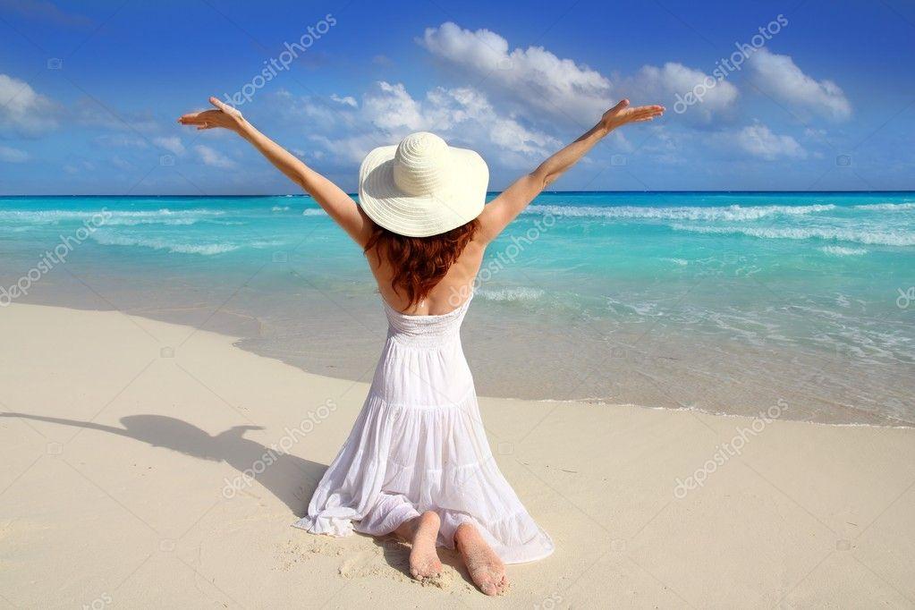 Caribbean Beach Woman Rear On Knees Open Arms Stock Photo