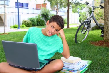 Boy teenager homework studying sitting garden