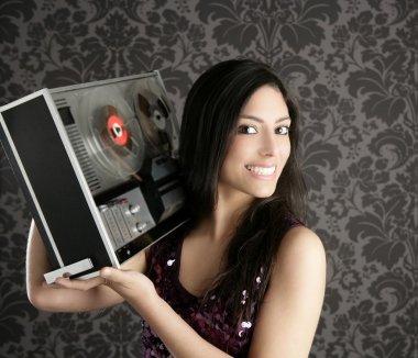 Retro open reel tape recorder beautiful brunette Dj