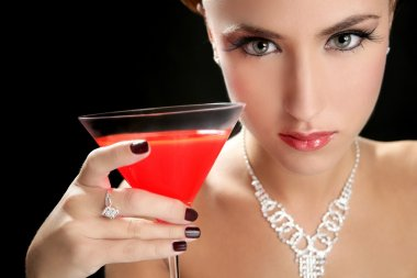 Attractive cocktail woman with martini red glass