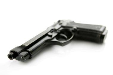 Black hand gun pistol over white background
