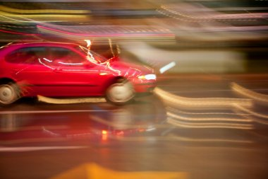 Car moving in rainy night motion blur