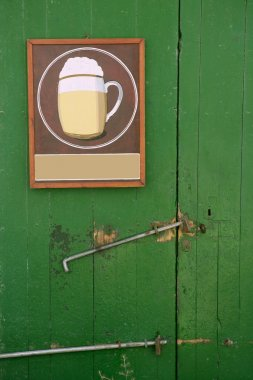 Beer draw poster in green wooden door