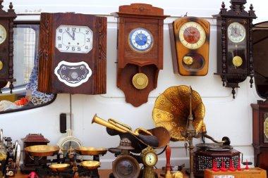 Antiques fair market wall old clocks
