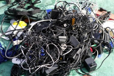 Battery charger and wires tech mess