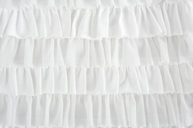 Pleated skirt fabric fashion in white closeup