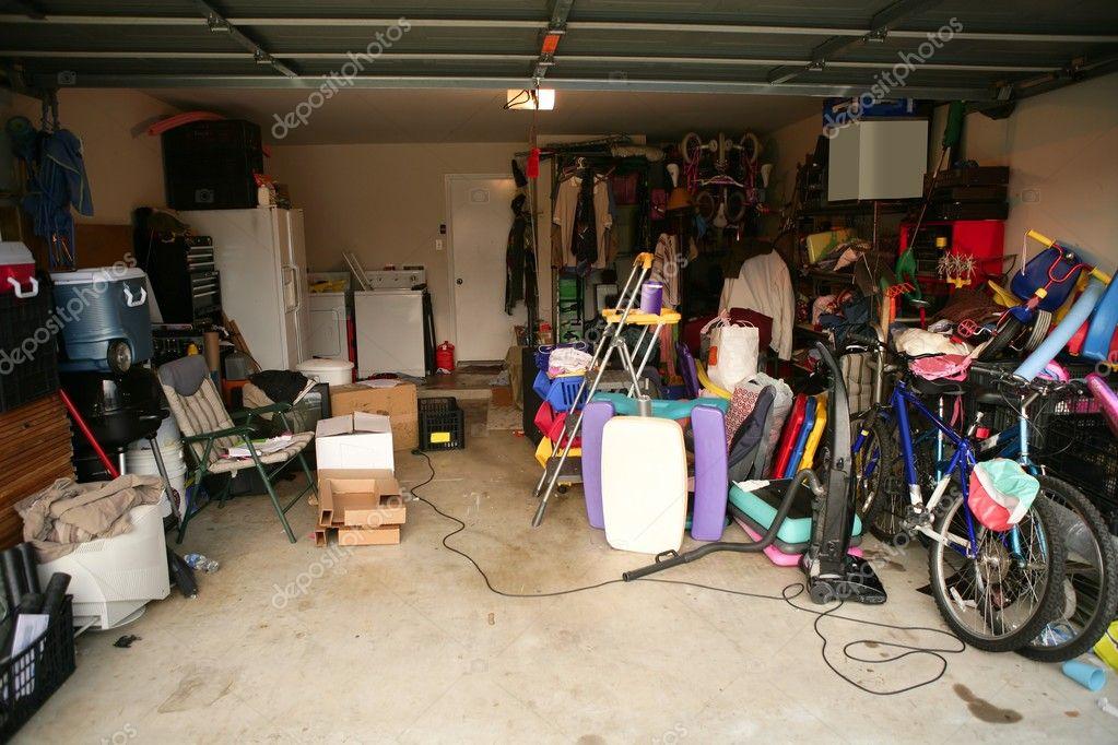 Messy abandoned garage full of stuff