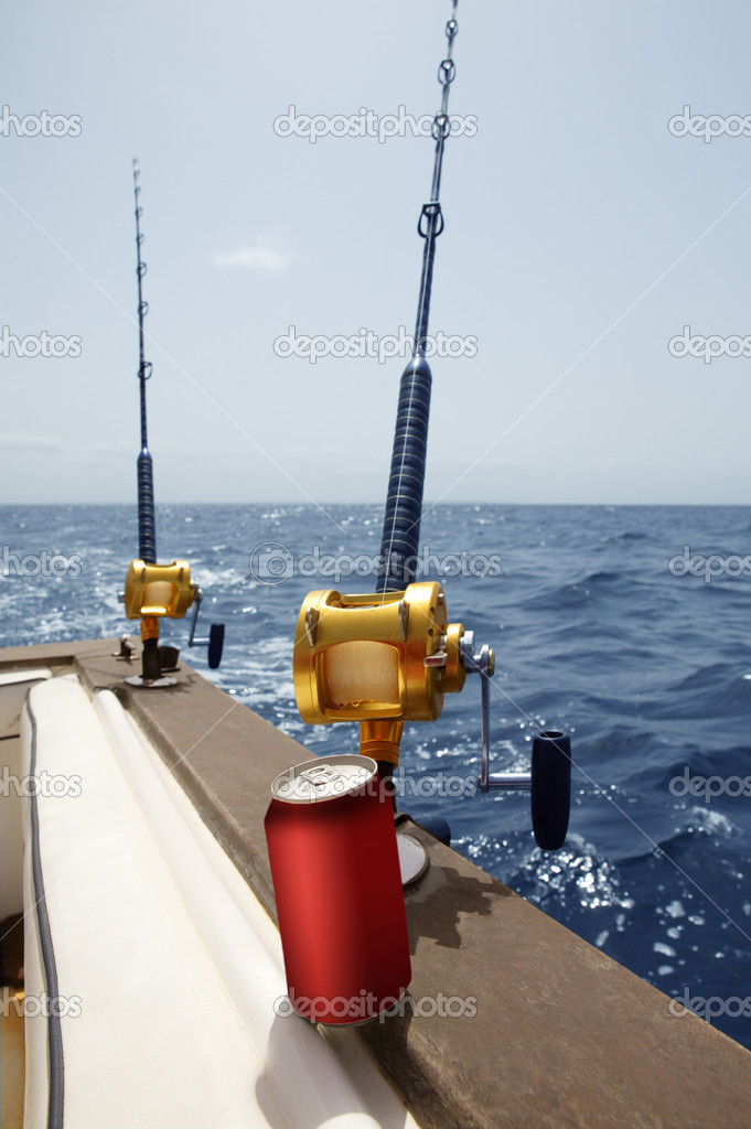 Fishing boat with rod and reels, african beverage