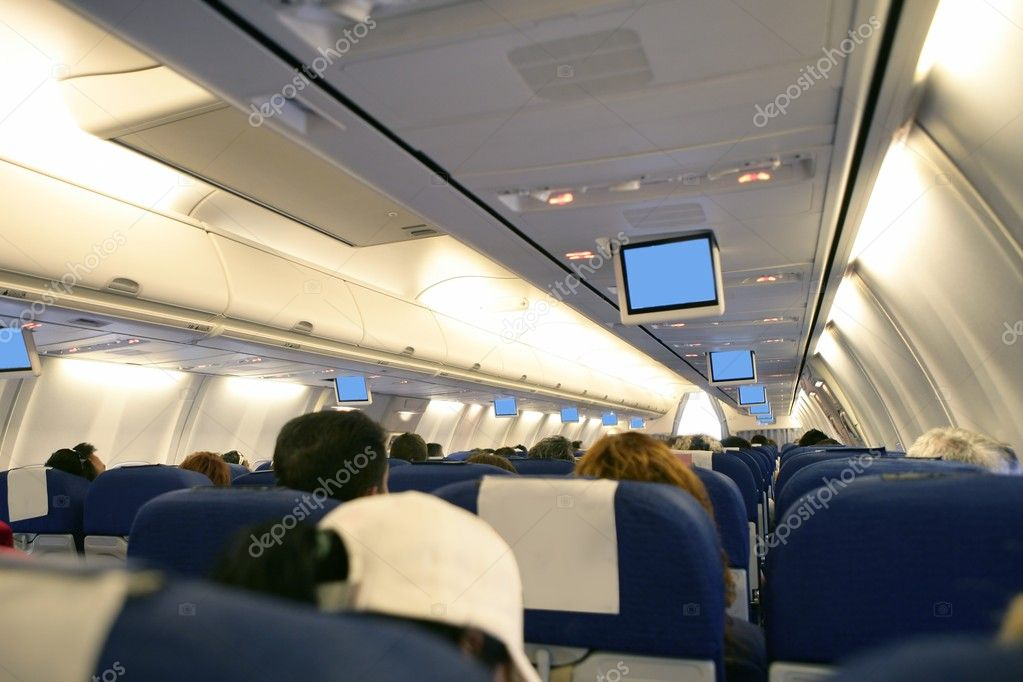 Airplane with passengers interior view