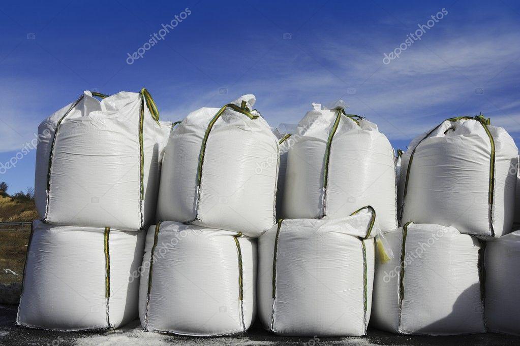 Salt white sacks rows stacked to road ice