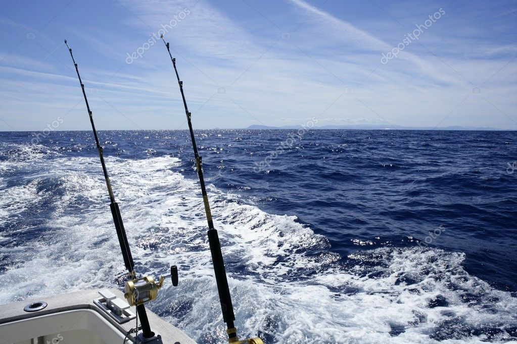 Fishing on the boat with trolling rod and reel.