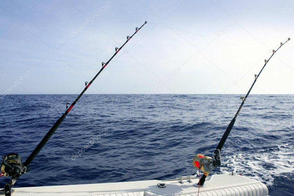 Blue Mediterranean fishing boat rod and reels