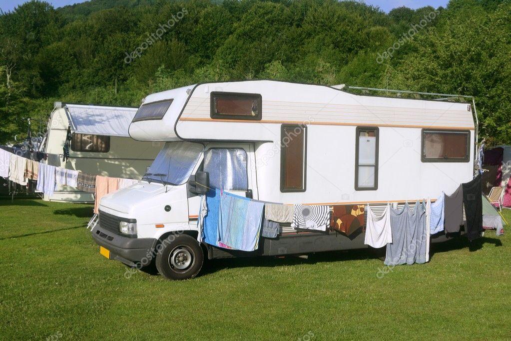 Caravan van in the green meadow camping