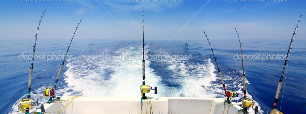 Boat fishing trolling panoramic rod and reels blue sea