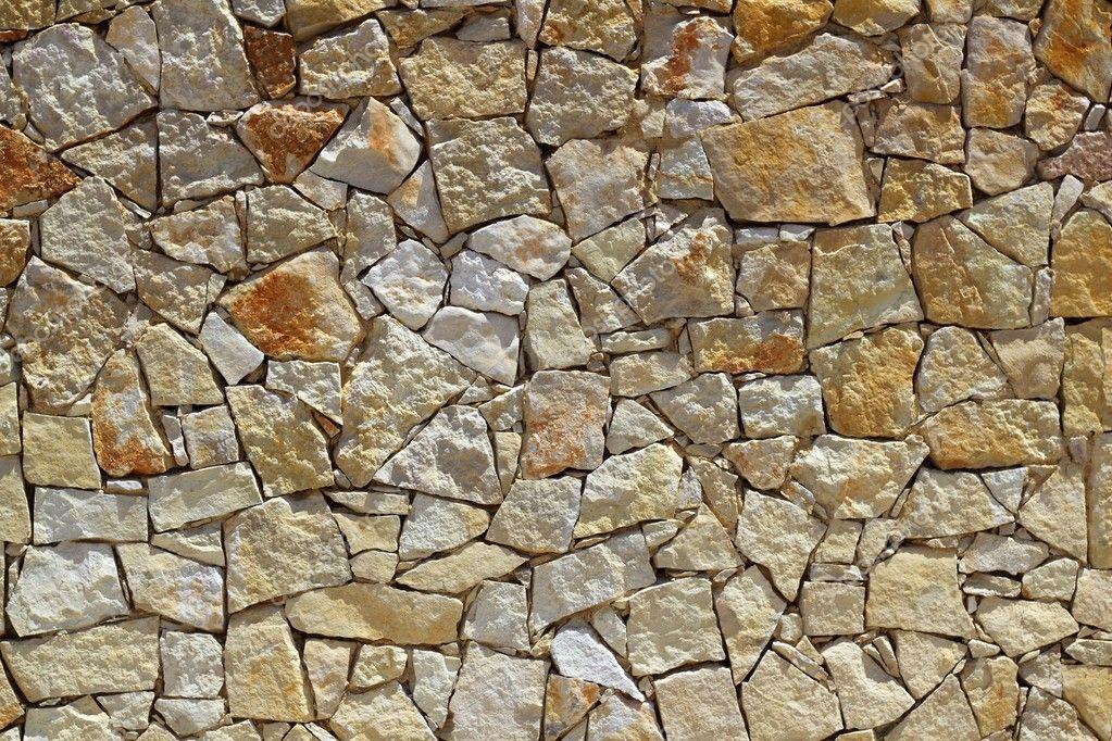 Masonry stone wall rock construction pattern stock photo for Pared granate