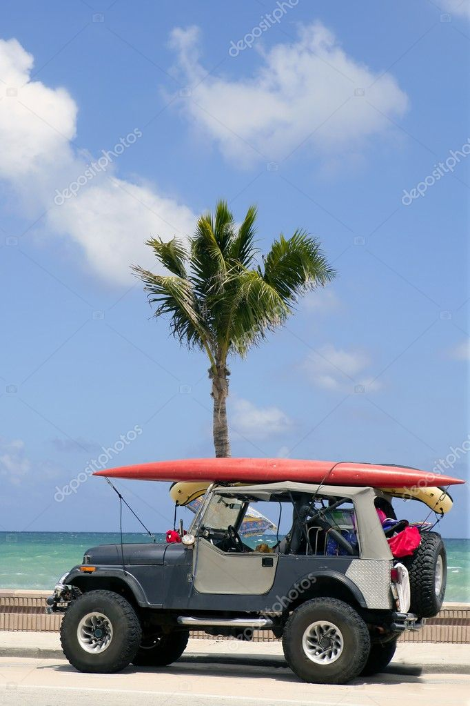 Florida surfer car with surfboard blue sky
