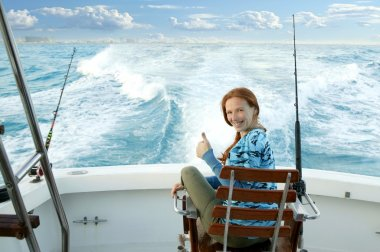 Fisherwoman big game on boat chair ok sign