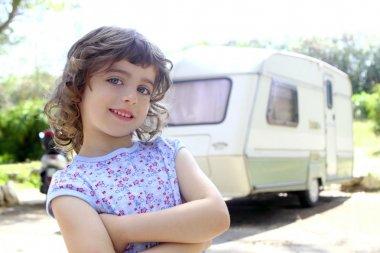 Little children girl posing caravan camping vacation