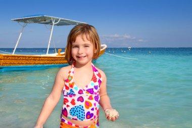 Blond beach little girl Caribbean vacation
