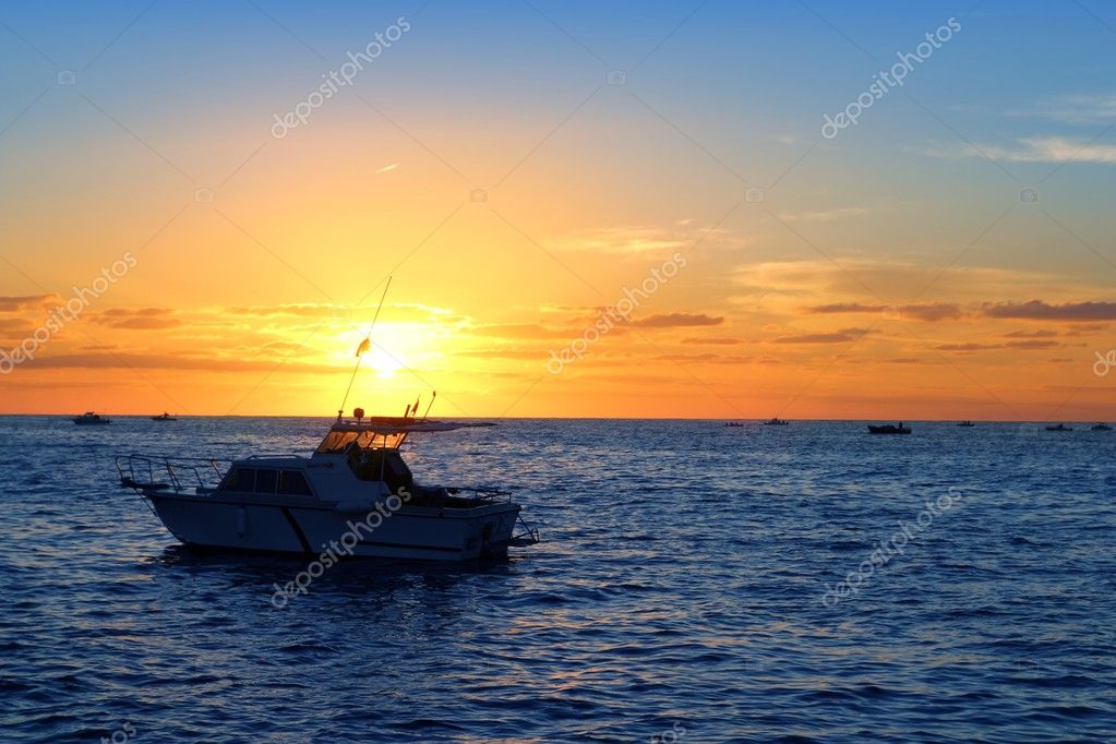 Sunrise fishing boat blue sea orange sky