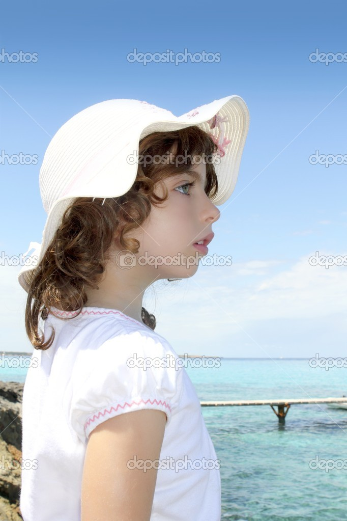 Tourist little girl hat formentera turquoise sea