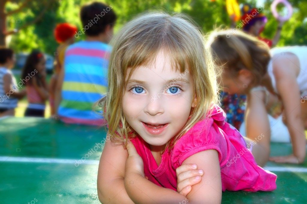 Happy little girl lying on table tennis park